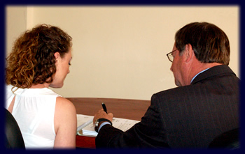 Image of attorney Bob Toy with a female client